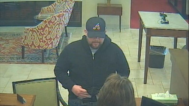 The Asheville Police Department is searching for a man who they say robbed the First Citizen Bank on Smokey Park Highway in Candler on April 7.