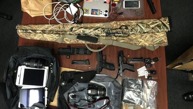 A number of possessions including computers, guns and cameras, stolen in a string of auto burglaries.