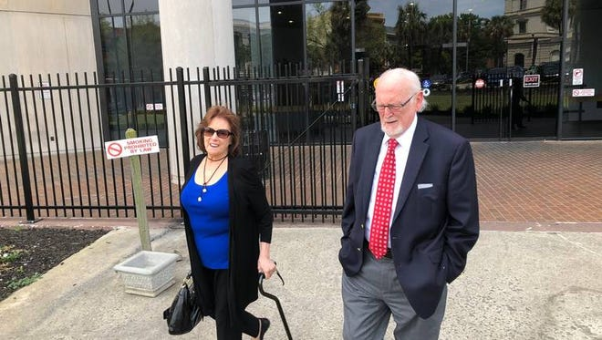 Richard Quinn Sr. and his wife, Ruth, leave court Tuesday