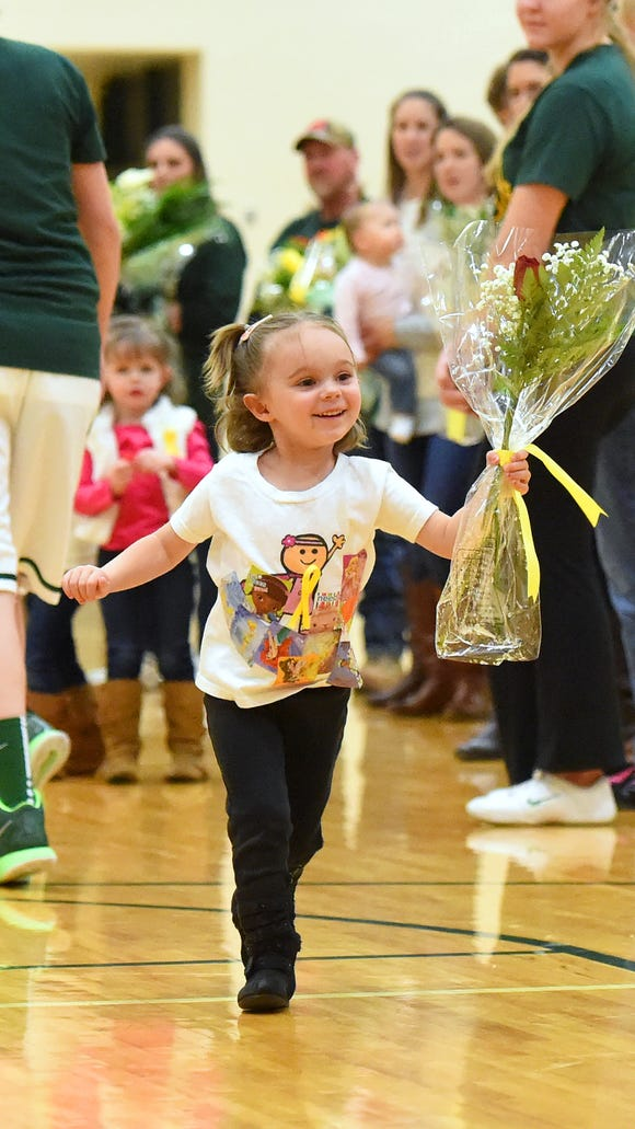 One of several, Raygan Batton, 3, runs across the gymnasium