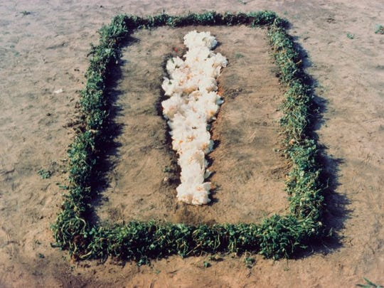 Ana Mendieta often used her own body, the landscape
