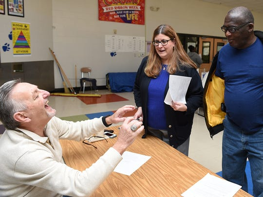 Nashville General Sessions Judge Casey Moreland, left, jokes with Rickie Dibrell, who appeared in court, which was held in the cafeteria at Croft Middle School on Feb. 6, 2016. Assistant Public Defender Joan Lawson, left, and Cassie Roberts, a first-year Vanderbilt Law School student, helped Dibrell with getting about $1,400 of his court costs waived.