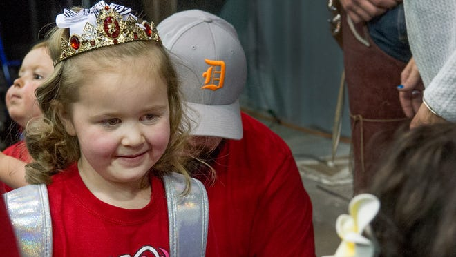 Kayla Maki, 5, reacts when meeting a Disney princess look-a-like on Tuesday, Jan. 30, 2018 at an Aggie basketball game at the Pan American Center.