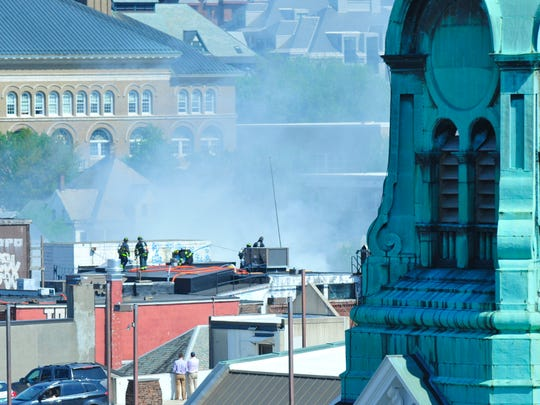 Burlington firefighters battle a blaze atop the old