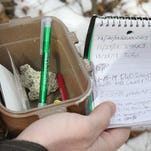 Eric Dalton of Aberdeen, a member of Central Jersey Geocaching, finds a cache, which he hid himself several years ago, on March 4 in an old cemetery in Neptune. Geocaching is a scavenger hunt where treasure seekers use a GPS to hide and seek containers filled with random objects left behind by fellow geocachers.
