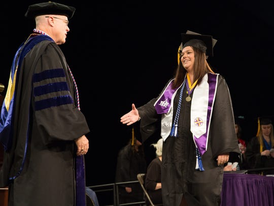 Chancellor Bernie Patterson conferred degrees on 1,400 students at the University of Wisconsin-Stevens Point's spring commencement ceremonies. Graduate Amanda Doperalski of Green Bay, majored in communications and was active in several student organizations.