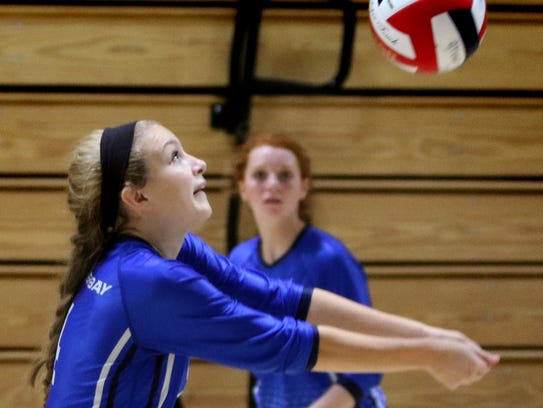 Whitefish Bay's Kelly Morello digs the ball out at