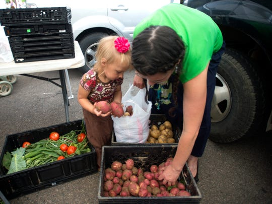 The CAMC Fort Collins Farmers Market offers a variety of local fruits and vegetables.