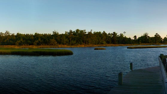 Stock panoramic view of the quiet and calm of Edisto, South Carolina Estuary at sunset.