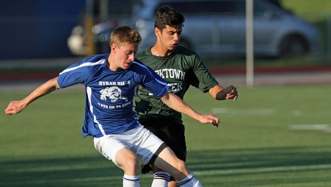 From left, Byram Hills' David Noel (20) and Yorktown's Giuliano Santucci (18) battle for ball control during the semifinal game of the Lakeland Boys Soccer Summer League at Walter Panas High School in Cortlandt July 28, 2015. Both players returned to their high school teams after previously playing for the U.S. Soccer Development Academy.