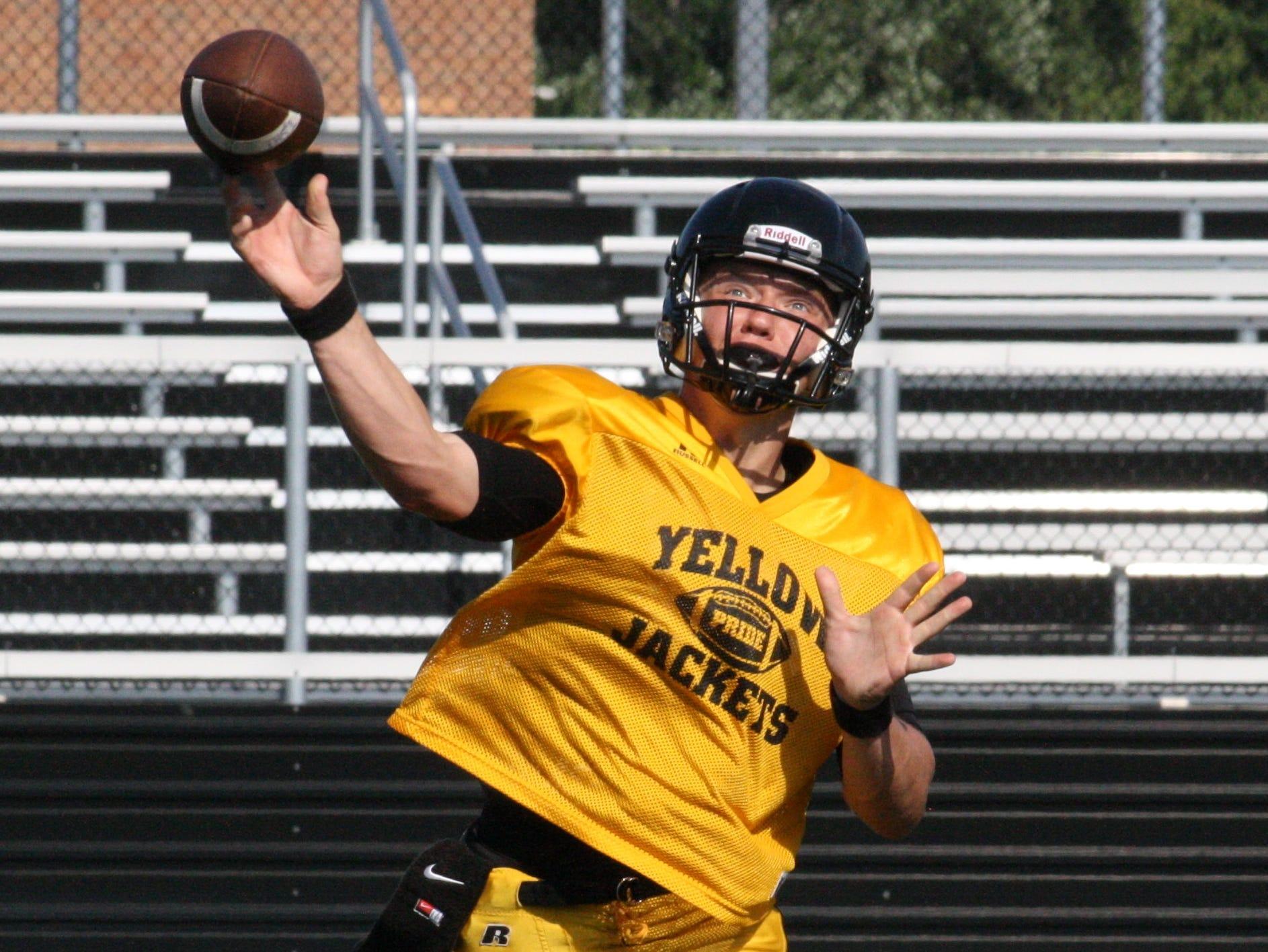 Taylor High School senior quarterback Nick Koehne throws a screen pass during practice Aug. 13.