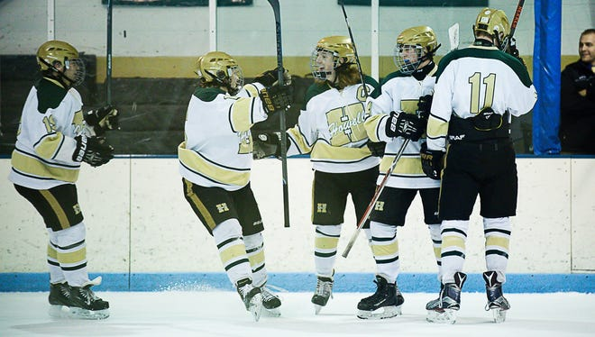 Howell players celebrate a goal in a 7-1 victory over Walled Lake Northern.