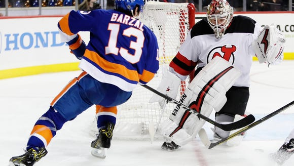 New Jersey Devils goaltender Keith Kinkaid (1) stops