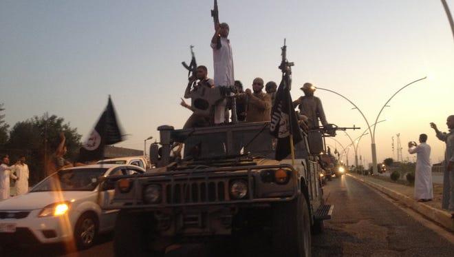 Islamic State fighters in Mosul, Iraq, in 2014.