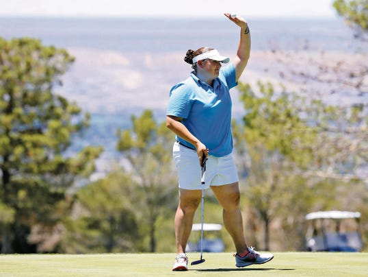 MARK LAMBIE—EL PASO TIMES  Brandi McKnight gives a wave to the crowd which gathered to watch her five-hole playoff with Soo Lee Friday at the Sun City Women's Golf Championship at Coronado Country Club.