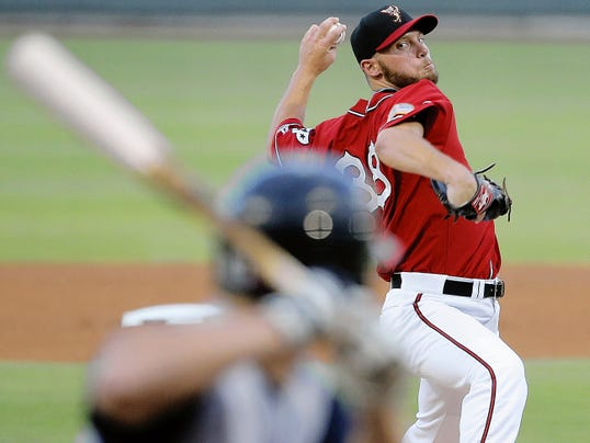Chihuahuas' pitcher Robbie Erlin delivers a pitch to a Sky Sox batter during their game at Southwest University Park.