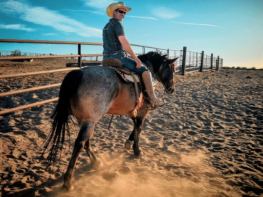 "Jim Brown, NMSU's rodeo team coach, rides Keystone. Brown described his job at NMSU: ""I feed the animals, design the posters, load the trailers, line up the rodeos — it's a lot of work, but it's rewarding."""
