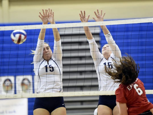 Chambersburg's Cara Long, left, and Lauren Diller, center, try to block a spike by Abby Smith, of Cumberland Valley, on Thursday. The Eagles won, 3-0.