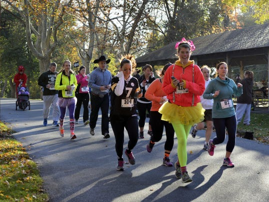 Runners in the 5K race, part of the Third Annual Northwest RoadRunner 5K and 1-Mile Fun Run, leave the starting line at Coleman Memorial Park on Saturday morning. Some participants turned out in Halloween costumes to celebrate the season.