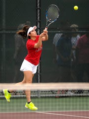 Corpus Christi Veterans Memorial's Loren Tristan returns a ball during the Class 5A girls doubles quarterfinals with partner Hailey Rios at the UIL State Tennis Championships on Thursday, May 18, 2017, at the George P. Mitchell Tennis Center in College Station.