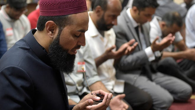Imam Azhar Subedar, left, speaks during a special prayer with non-Muslim members of the community at the American Muslim Community Center Monday, June 13, 2016, in Longwood, Fla., after the mass-shooting at the Pulse Orlando nightclub.