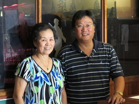 Jenny Ching and son Jesse Ching pose just outside the glassed-in bar at The Sportsman restaurant in Ventura. The family also operates The Sportsman in Camarillo.