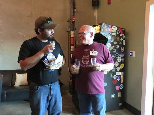 Homebrewers Ivan Ortiz, left, and Ron Baran compare notes during the Pure InFATuation Brew Competition Sept. 26 at Casa Agria Specialty Ales in Oxnard. The by-invitation event featured 12 beers made by Ventura Independent Beer Enthusiasts members using full advance treated (FAT) recycled water.