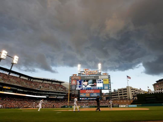Storm clouds move in as Tigers third baseman Nick Castellanos runs to first on his fly out to center during the fourth inning on Friday, July 14, 2017, at Comerica Park.