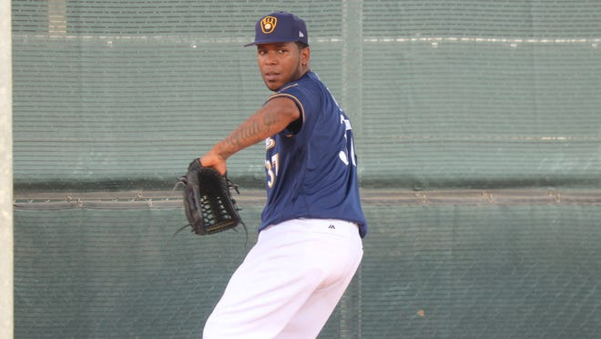 Brewers reliever Neftali Feliz worked out Monday for the first time with his new team.