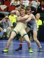 Iowa City West junior Nelson Brands, left, scrambles to break free from Waverly-Shell Rock senior Austin Yant in their Class 3A match at 152 pounds on Friday, Feb. 17, 2017, at Wells Fargo Arena in Des Moines.