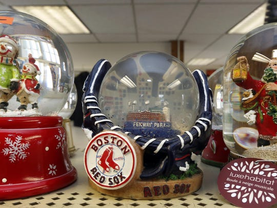 Several snow globes sit at the surplus center warehouse in Concord, N.H. The warehouse is open to the public on Mondays, and manager John Supry says buyers line up at the door.