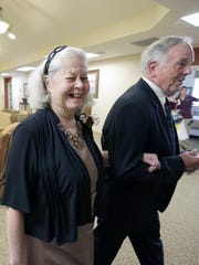 """Walt and Aline Zerrenner share a laugh as they head off to  dinner during """"Prom Night"""" at Touchmark on West Prospect in Appleton. Aline now lives at Touchmark as she and Walt deal with her Alzheimer's."""