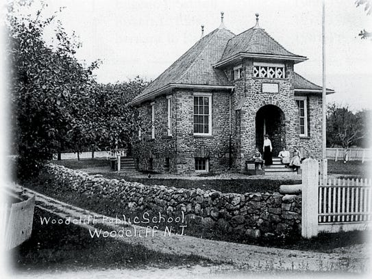Postcard of Woodcliff School with rock wall fence circa