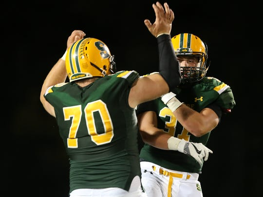 Sycamore Aviators linebacker Kyle Fehr (31), right, celebrates an interception with offensive lineman Tate Goodyear (70) in the fourth quarter during the high school football game between the Mason Comets and the Sycamore Aviators, Friday, Sept. 8, 2017, at Sycamore Junior High School in Montgomery, Ohio.
