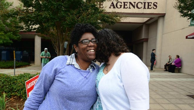 Rachael Duncan, left, and Brianna Watts, right, stand outside Greenville County Square on Wednesday, October 8, 2014 after being denied a marriage license.