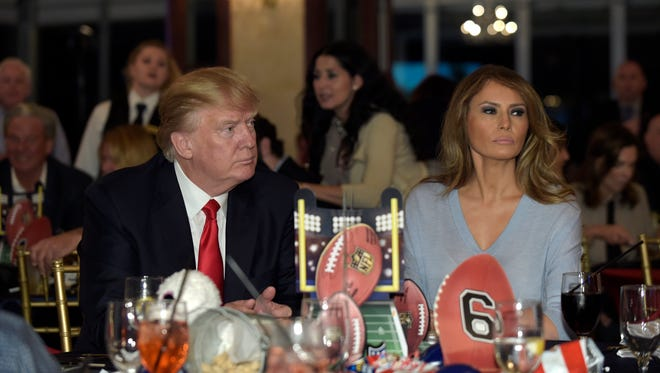 President Donald Trump and First Lady Melania Trump watch the Super Bowl at a party at Trump International Golf Club in West Palm Beach, Fla.