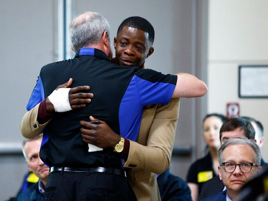 James Shaw gets a hug from Waffle House CEO Walt Ehmer