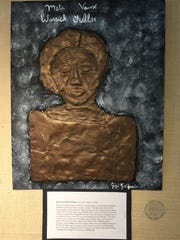 """Eight-grader Gigi Goldfisher created a sculptural bas relief portrait of sculptor Meta Vaux Fuller, whose famous works included """"Emancipation,"""" created in honor of the 50th anniversary of the Emancipation Proclamation."""