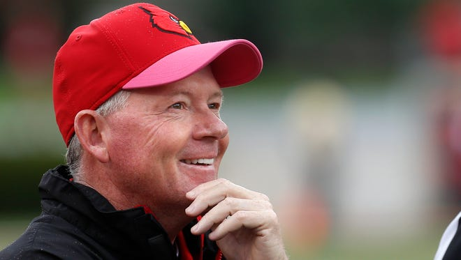 Louisville's coach Bobby Petrino looks at the replay on the big screen during a review. 