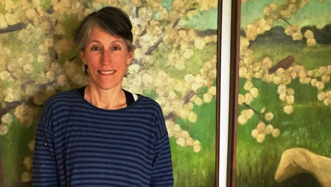 Wisconsin novelist Jane Hamilton, in her kitchen in front of a painting by her friend Laura Dronzek, will give the keynote talk at the Southeast Wisconsin Festival of Books.