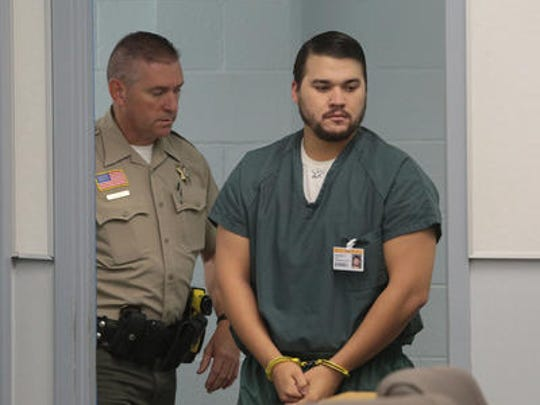 Christopher Lee is shown in San Bernardino County Superior Court in this file photo. He's accused of killing Erin Corwin, a Marine wife who disappeared and was found in a mine shaft in August.