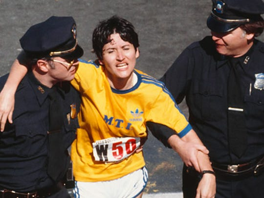 Rosie Ruiz is escorted by police after cheating in the 1980 Boston Marathon.