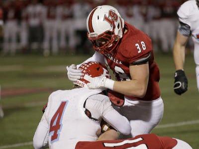 La Salle's Hayden Jester and Nolan Keller tackle Kings quarterback Tyler Knecht during their playoff game Nov. 20.