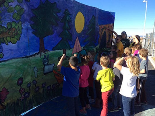 Three Peaks had some very special guests from Opera By Children drive all the way down from Logan to help students paint their opera backdrops.
