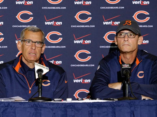 Chicago Bears general manager Phil Emery, left, talks to the media as head coach Marc Trestman listens at a news conference during the team's NFL football training camp at Olivet Nazarene University on Wednesday, July 23, 2014., in Bourbonnais, Ill. (AP Photo/Nam Y. Huh)