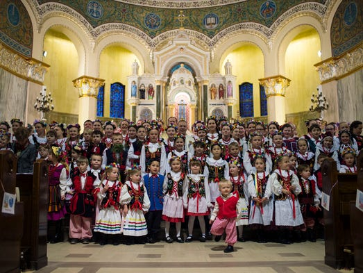 Polish American dancers pose for a photo after the
