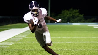 Lance Wilhoite (6) runs a drill during Franklin Road Academy's first football practice of the season in full pads, shortly after midnight on Monday, July 23, 2018, at Franklin Road Academy in Nashville, Tenn.