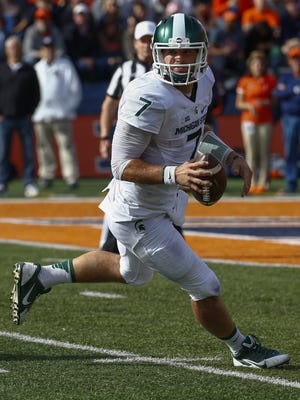 Tyler O'Connor of the Michigan State Spartans scrambles out of the pocket during the game against the Illinois Fighting Illini at Memorial Stadium on November 5, 2016 in Champaign, Illinois.