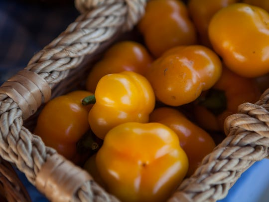 Sweet peppers sit on display at Gatherings' booth in
