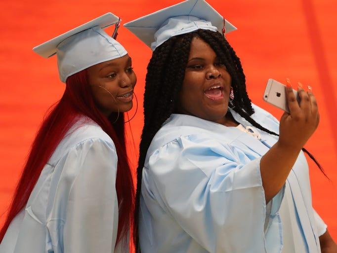 Graduates Precious Samiyaha Hopkins (left) and Kya